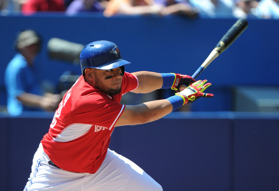 Photo - Toronto Blue Jays' Melky Cabrera singles against the Detroit Tigers during the first inning of a baseball game on Sunday, Aug. 10, 2014, in Toronto.  (AP Photo/The Canadian Press, Jon Blacker)