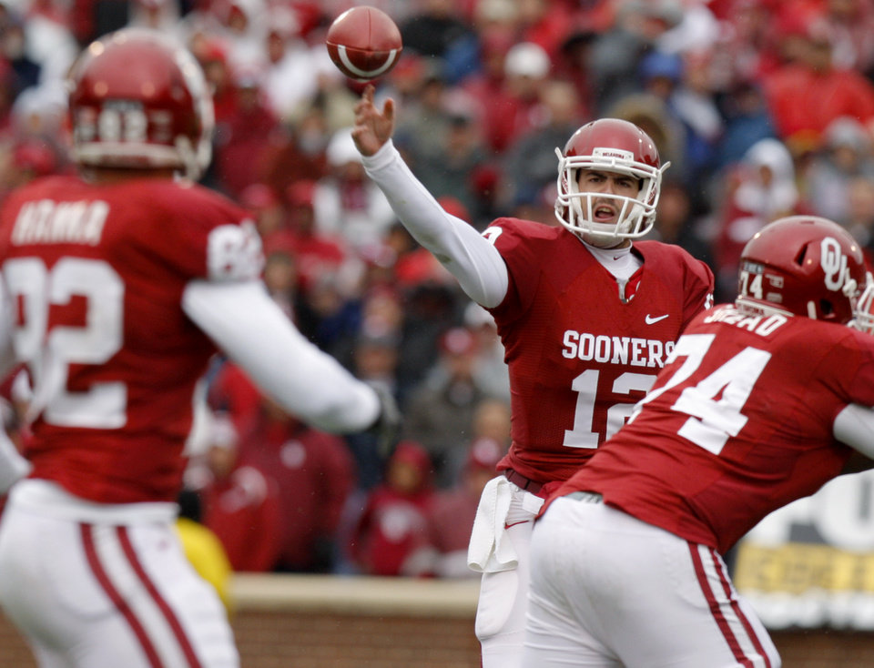 Photo - Oklahoma's Landry Jones (12) throws  pass during a college football game between the University of Oklahoma Sooners (OU) and the Iowa State University Cyclones (ISU) at Gaylord Family-Oklahoma Memorial Stadium in Norman, Okla., Saturday, Nov. 26, 2011. Photo by Bryan Terry, The Oklahoman