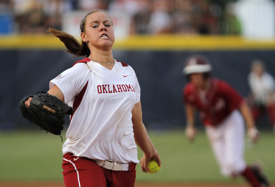 Photo - Oklahoma's Keilani Ricketts (10) pitches during a Women's College World Series softball game between OU and Alabama at ASA Hall of Fame Stadium in Oklahoma City, Tuesday, June 5, 2012.  Photo by Garett Fisbeck, The Oklahoman