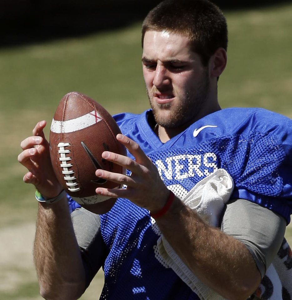 Photo - Quarterback Trevor Knight goes through drills as the University of Oklahoma Sooners (OU) begin spring practice on Owen Field at Gaylord Family-Oklahoma Memorial Stadium in Norman, Okla., on Tuesday, March 11, 2014. Photo by Steve Sisney, The Oklahoman