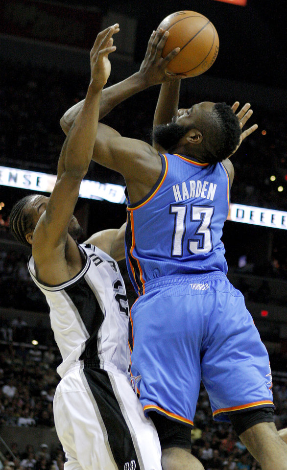 Photo - Oklahoma City's James Harden (13) tries to put up a shot as he runs into San Antonio's Kawhi Leonard (2) during Game 1 of the Western Conference Finals between the Oklahoma City Thunder and the San Antonio Spurs in the NBA playoffs at the AT&T Center in San Antonio, Texas, Sunday, May 27, 2012. Oklahoma City lost 101-98. Photo by Bryan Terry, The Oklahoman