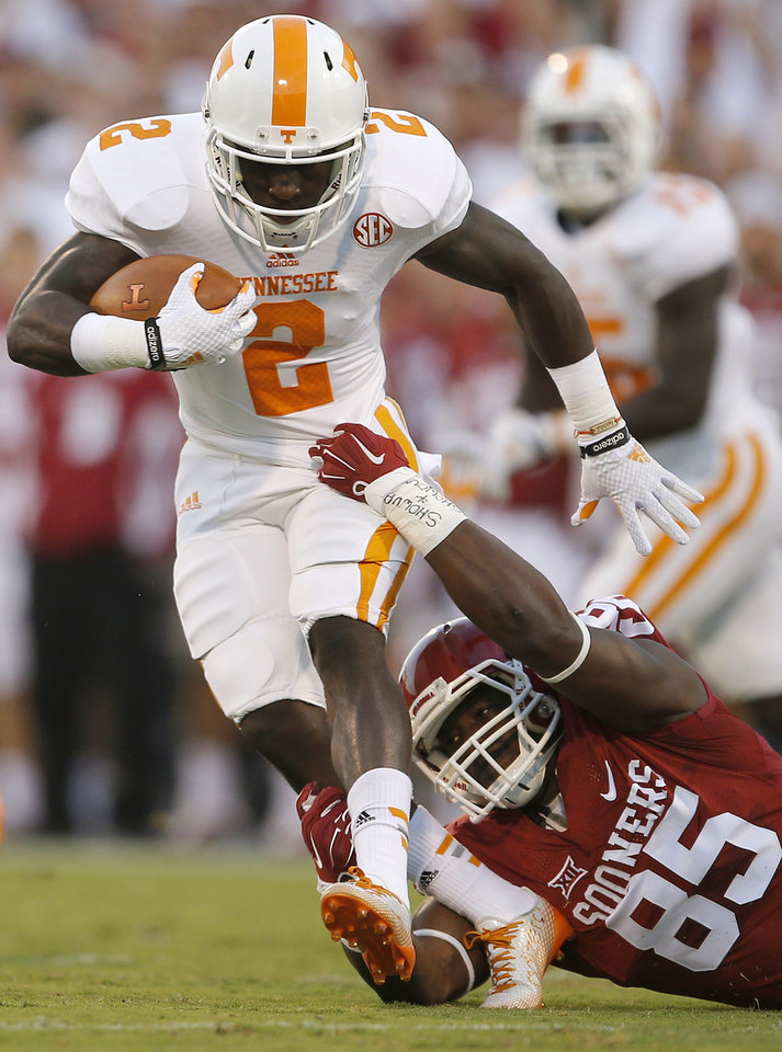 Photo - Oklahoma's Geneo Grissom (85) brings down Tennessee's Pig Howard (2) during a college football game between the University of Oklahoma Sooners (OU) and the Tennessee Volunteers at Gaylord Family-Oklahoma Memorial Stadium in Norman, Okla., on Saturday, Sept. 13, 2014. Photo by Bryan Terry, The Oklahoman