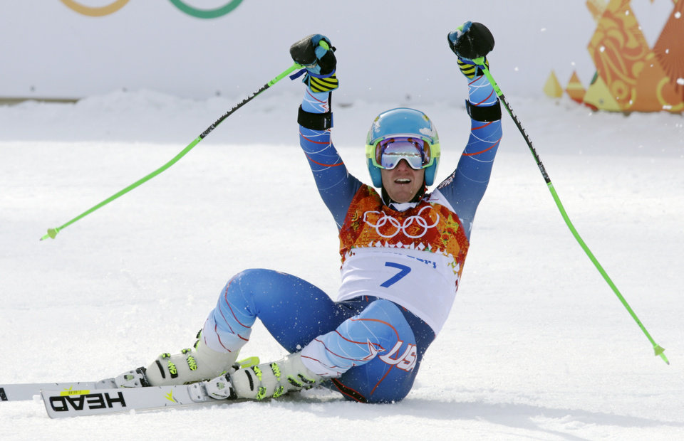 Photo - United States' Ted Ligety celebrates after winning the gold medal in the men's giant slalom at the Sochi 2014 Winter Olympics, Wednesday, Feb. 19, 2014, in Krasnaya Polyana, Russia.(AP Photo/Gero Breloer)