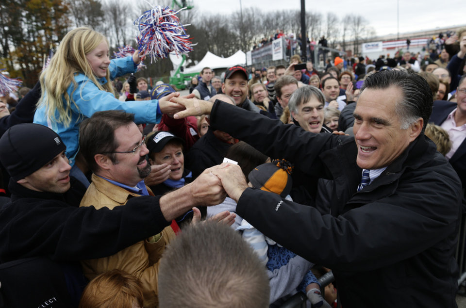 Photo -   Republican presidential candidate and former Massachusetts Gov. Mitt Romney greets supporters as he campaigns at Portsmouth International Airport, in Newington, N.H., Saturday, Nov. 3, 2012. (AP Photo/Charles Dharapak)