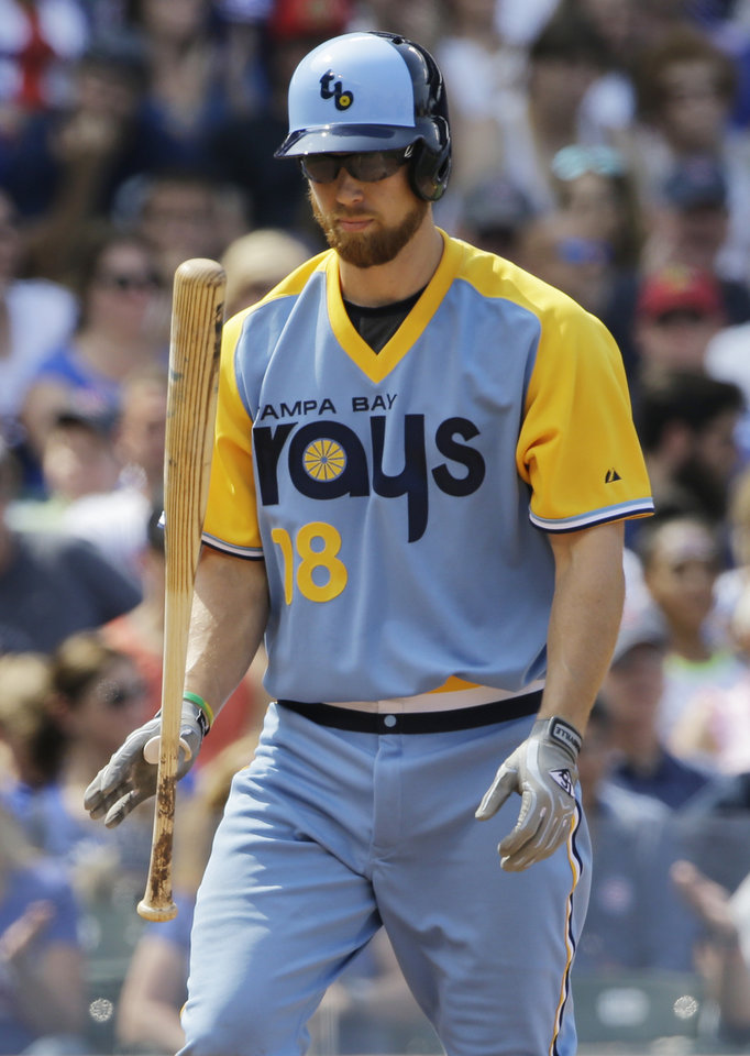 Photo - Tampa Bay Rays' Ben Zobrist tosses his bat after being called out on strikes during the fifth inning of an interleague baseball game against the Chicago Cubs in Chicago, Sunday, Aug. 10, 2014. (AP Photo/Nam Y. Huh)