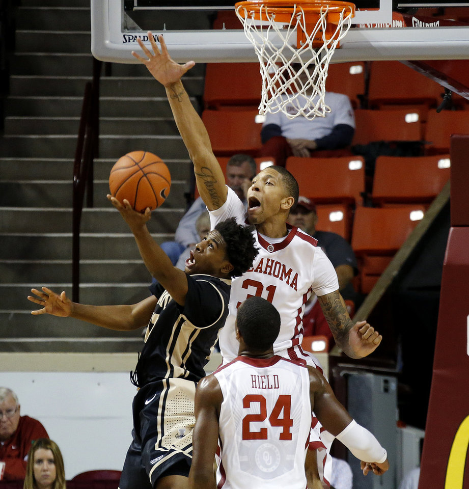 Photo - Oklahoma's D.J. Bennett (31) blocks the shot of Idaho's Mike Scott (12) during a college basketball game between the University of Oklahoma Sooners and the Idaho Vandals at Lloyd Noble Center in Norman, Okla., on Wednesday, Nov. 13, 2013. Wednesday, Nov. 13, 2013. Photo by Bryan Terry, The Oklahoman