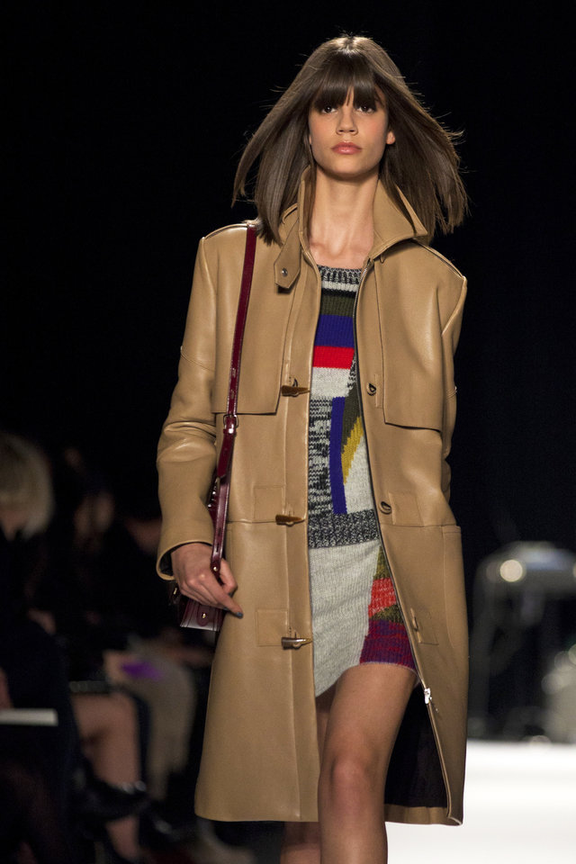 Photo - A model walks the runway during the Rebecca Minkoff Fall 2013 fashion show during Fashion Week, Friday, Feb. 8, 2013, in New York. (AP Photo/Karly Domb Sadof)