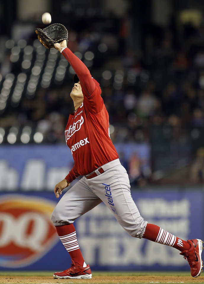 Photo - Mexico City Red Devils first baseman Mario Valdez (24) catches a pop fly hit by Texas Rangers' Nelson Cruz during the sixth inning of a spring training exhibition baseball game, Thursday, March 28, 2013, in Arlington, Texas. (AP Photo/The Fort Worth Star-Telegram, Brandon Wade)  MAGS OUT; (FORT WORTH WEEKLY, 360 WEST); INTERNET OUT