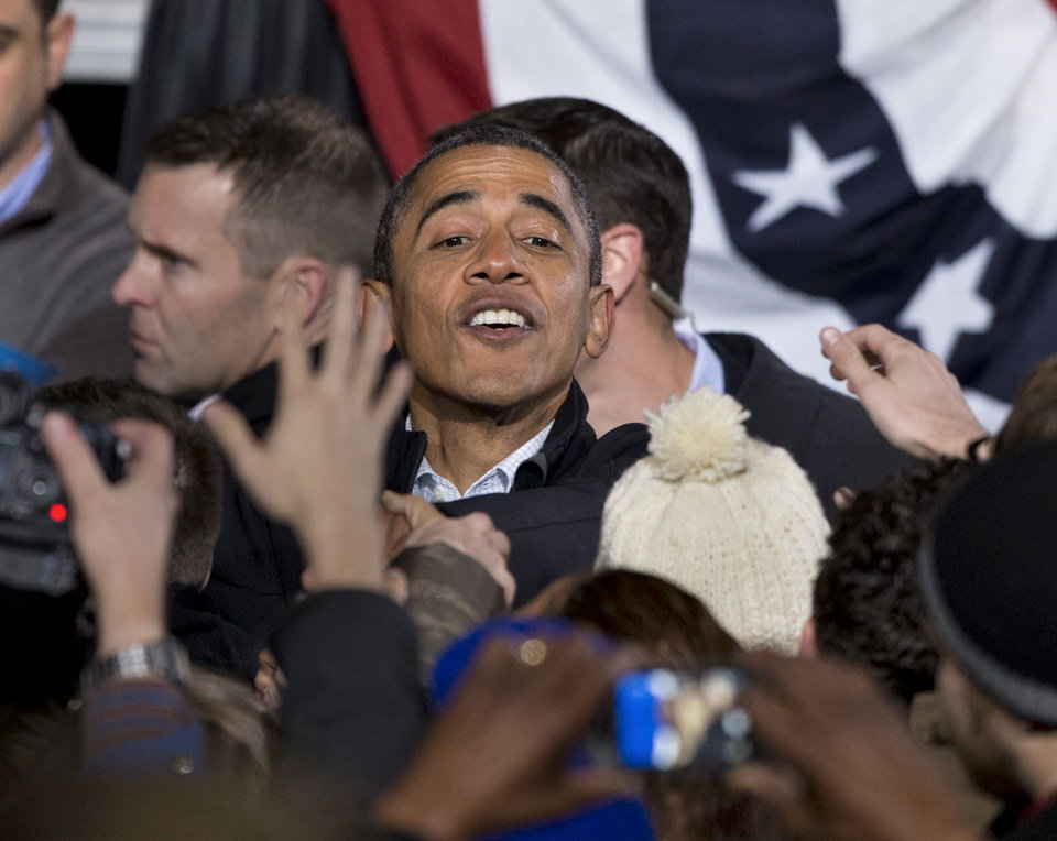 In the final hours of a four-state campaign day, President Barack Obama greets supporters at a rally at Jiffy Lube Live arena, late Saturday night, Nov. 3, 2012, in Bristow, Va. Virginia is one of the most closely contested battleground states. (AP Photo/J. Scott Applewhite)
