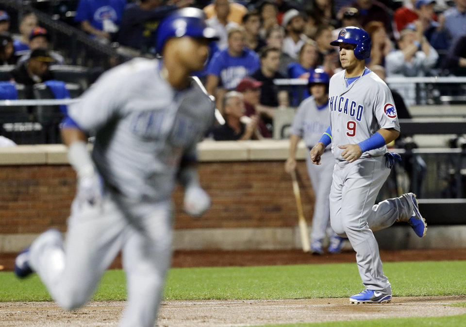 Photo - Chicago Cubs' Javier Baez, right, scores on an RBI single from Starlin Castro, left, during the third inning of a baseball game against the New York Mets, Friday, Aug. 15, 2014, in New York. (AP Photo/Frank Franklin II)