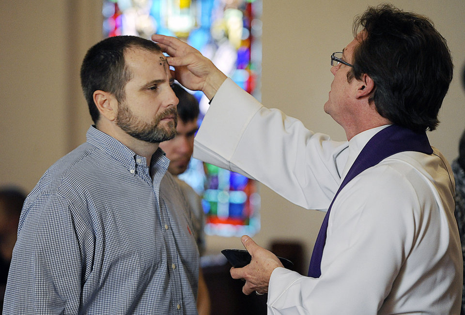Congregant Rip Gibbs, left, receives the imposition of ashes during Ash Wednesday services from the Rev. Howard Castleberry on Wednesday, Feb. 22, 2012, at Christ Episcopal Church in Nacogdoches, Texas. ( (AP Photo/Nacogdoches Daily Sentinel, Andrew D. Brosig) MANDATORY CREDIT