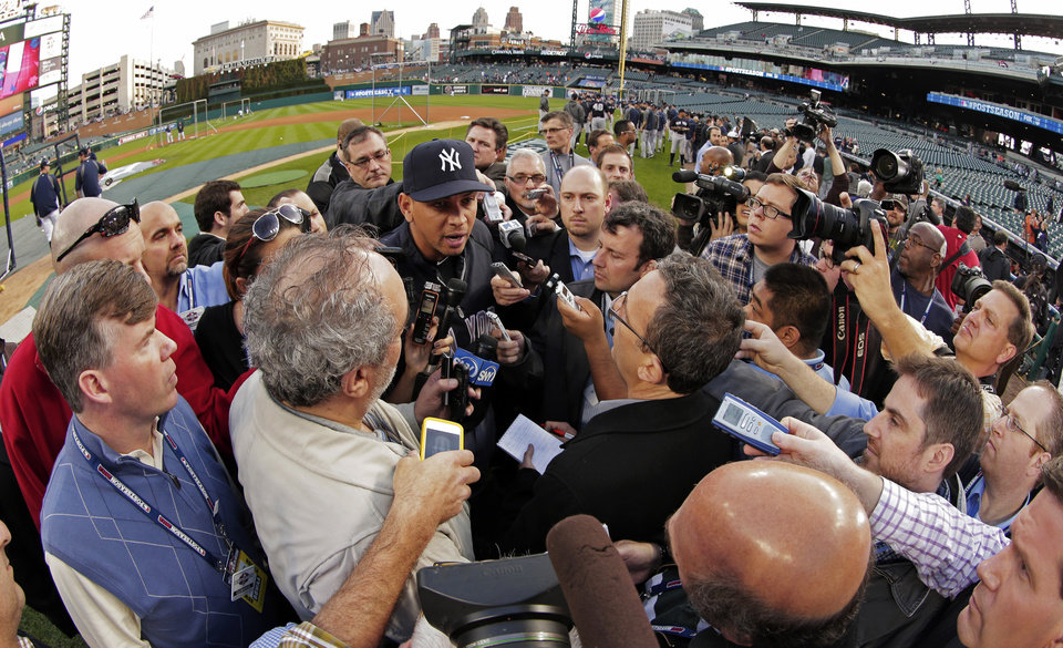 Photo -   New York Yankees' Alex Rodriguez responds to a question from the news media before Game 4 of the American League championship series against the Detroit Tigers Wednesday, Oct. 17, 2012, in Detroit. (AP Photo/Charlie Riedel)