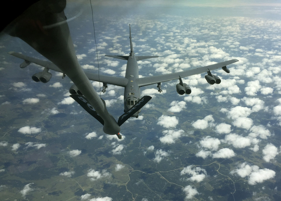 Photo -  A B-52 Stratofortress maneuvers into position during a practice rendezvous with a KC-135 Stratotanker. The tanker's crew are members of the 507th Air Refueling Wing, a U.S. Air Force Reserve unit based at Tinker Air Force Base. [Photo by Paul Hellstern, The Oklahoman]
