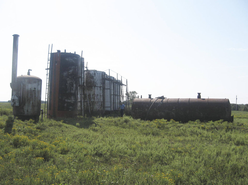 Contractors hired by the Oklahoma Energy Resources Board removed these rusty, abandoned storage tanks from the Osage County property owned by Earl and Dorothy Fink. It was OERB's 12,000th cleanup. <strong> - provided</strong>