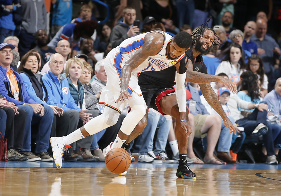 Photo - Oklahoma City's Paul George (13) goes for the ball beside Miami's James Johnson (16) during an NBA basketball game between the Oklahoma City Thunder and the Miami Heat at Chesapeake Energy Arena in Oklahoma City, Monday, March 18, 2019. Miami won 116-107. Photo by Bryan Terry, The Oklahoman