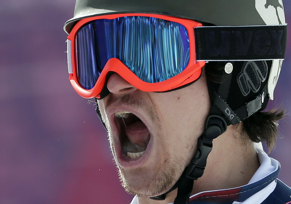Photo - Russia's Vic Wild celebrates his win in a snowboard parallel slalom semifinal at the Rosa Khutor Extreme Park, at the 2014 Winter Olympics, Saturday, Feb. 22, 2014, in Krasnaya Polyana, Russia. (AP Photo/Andy Wong)