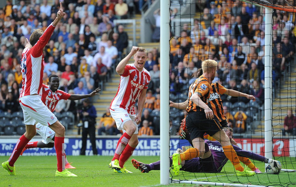 Photo - Stoke City's Ryan Shawcross, centre, jubilates after scoring his teams first goal against Hull City, during their English Premier League match at the KC Stadium, Hull, England, Sunday Aug, 24, 2014. (AP Photo/PA, Martin Rickett)   UNITED KINGDOM OUT  NO SALES  NO ARCHIVE