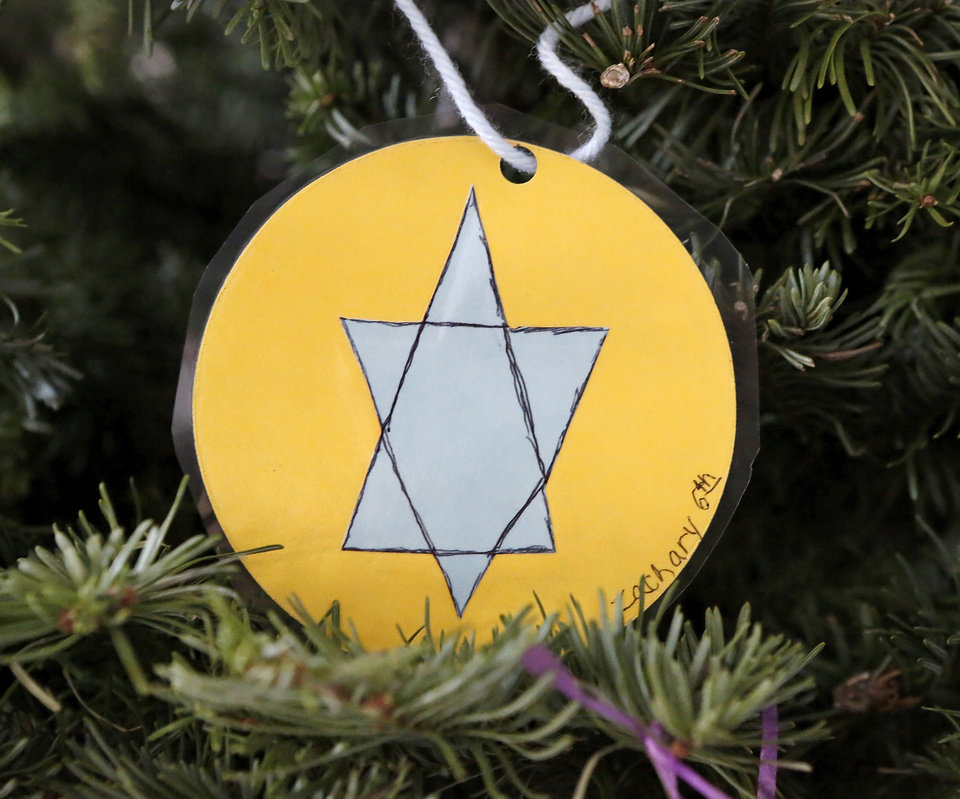 Photo - Above: A Star of David ornament hanging on the Jesse Tree at St. James the Greater Catholic represents King David.