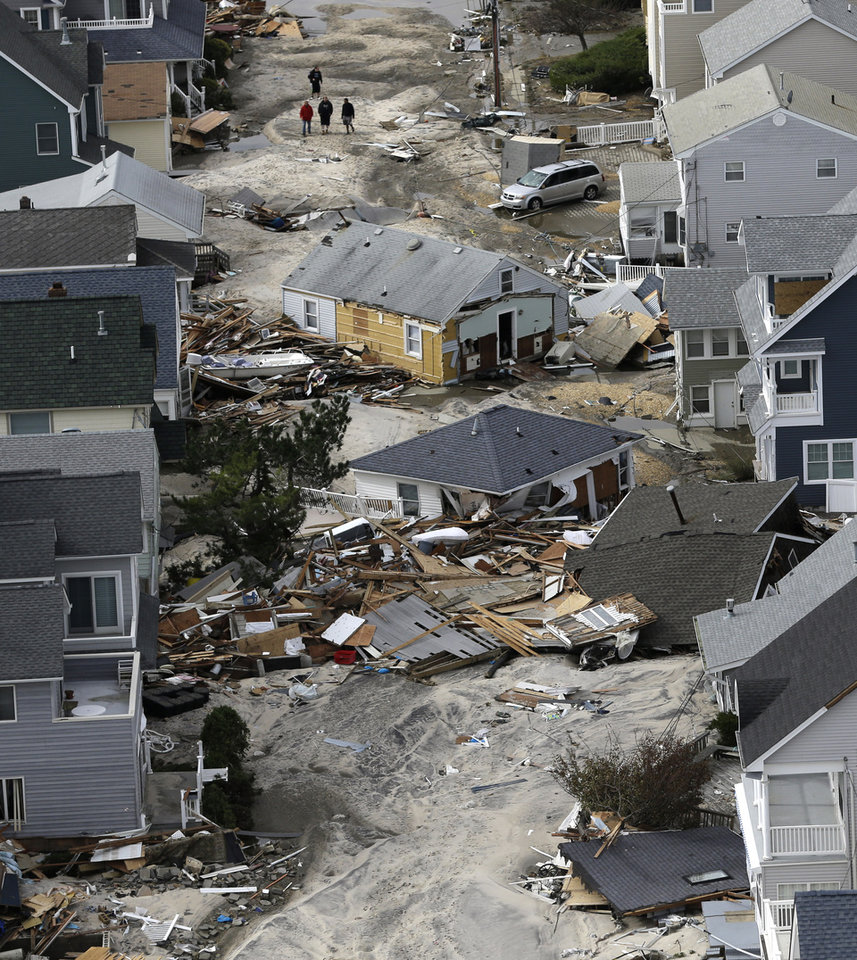 Photo - This aerial photo shows the destroyed homes  left in the wake of superstorm Sandy on Wednesday, Oct. 31, 2012, in Seaside Heights, N.J. New Jersey got the brunt of Sandy, which made landfall in the state and killed six people. More than 2 million customers were without power as of Wednesday afternoon, down from a peak of 2.7 million. (AP Photo/Mike Groll) ORG XMIT: NJMG114