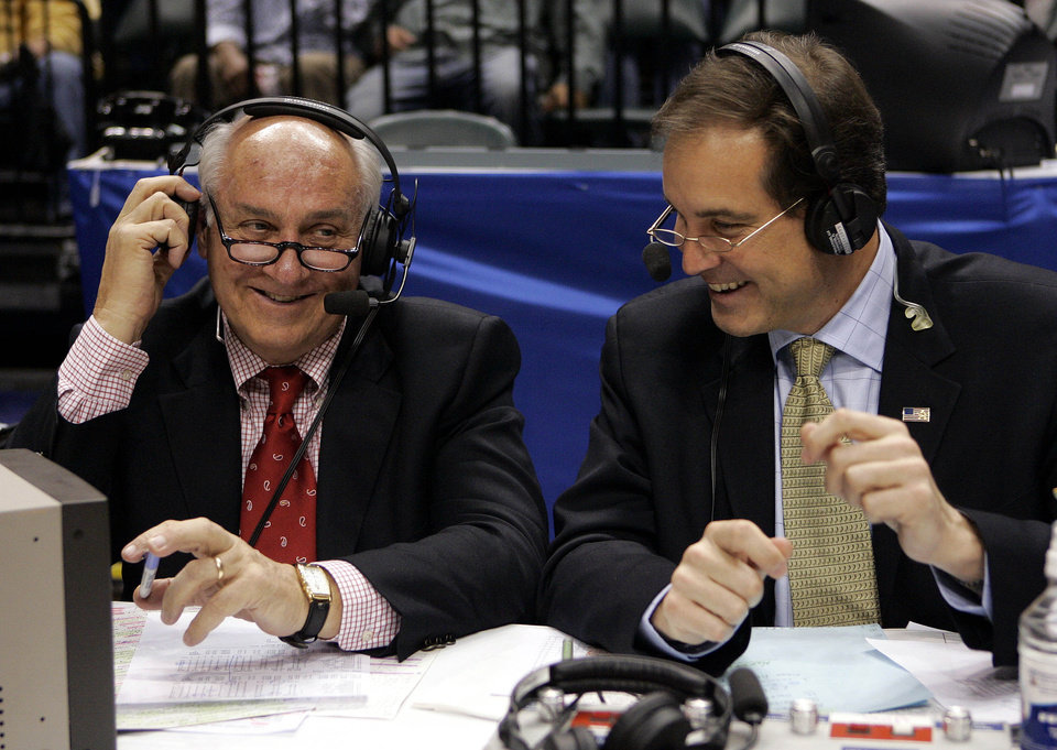 Photo - CBS announcers Billy Packer, left, and Jim Nantz laugh during a break in the action in the championship basketball game in the Big Ten Conference tournament  in Indianapolis, Sunday, March 12, 2006. Craig Littlepage, the NCAA Tournament selection committee chairman, took aim at critics of the NCAA selection committee Monday, even firing back at CBS. One day after the committee was harshly criticized for its 65-team field, its chairman defended the panel's work saying he wanted a better working relationship with the NCAA's $6 billion broadcast partner.(AP Photo/Michael Conroy)