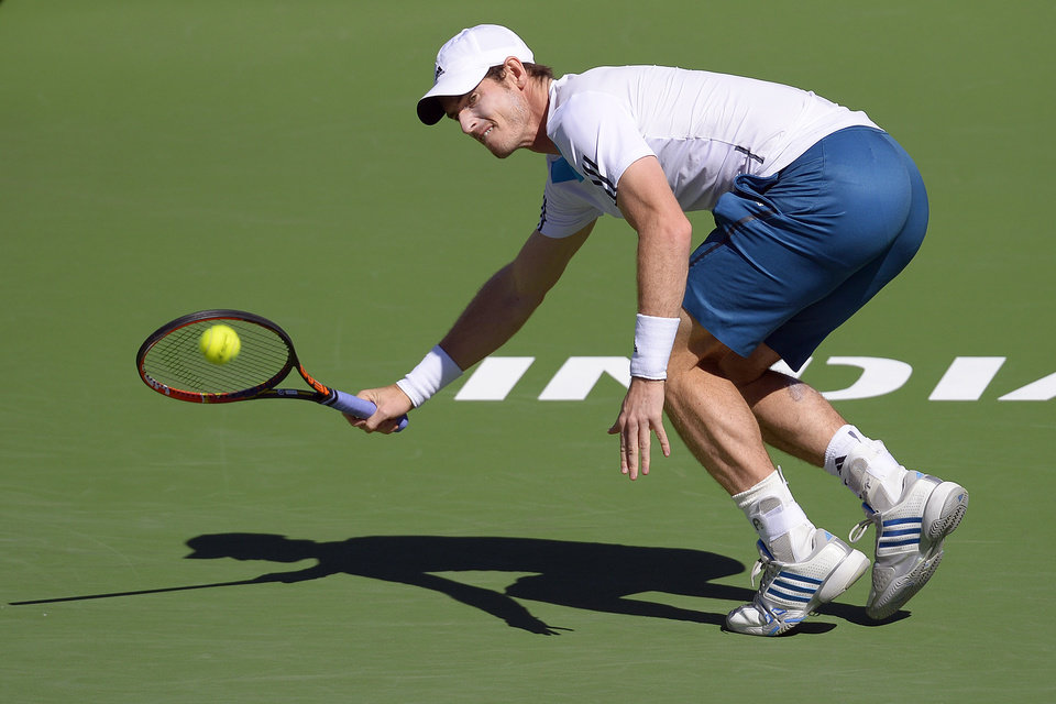Photo - Andy Murray, of Great Britain, returns a shot against Milos Raonic, of Canada, during a fourth round match at the BNP Paribas Open tennis tournament, Wednesday, March 12, 2014, in Indian Wells, Calif. (AP Photo/Mark J. Terrill)