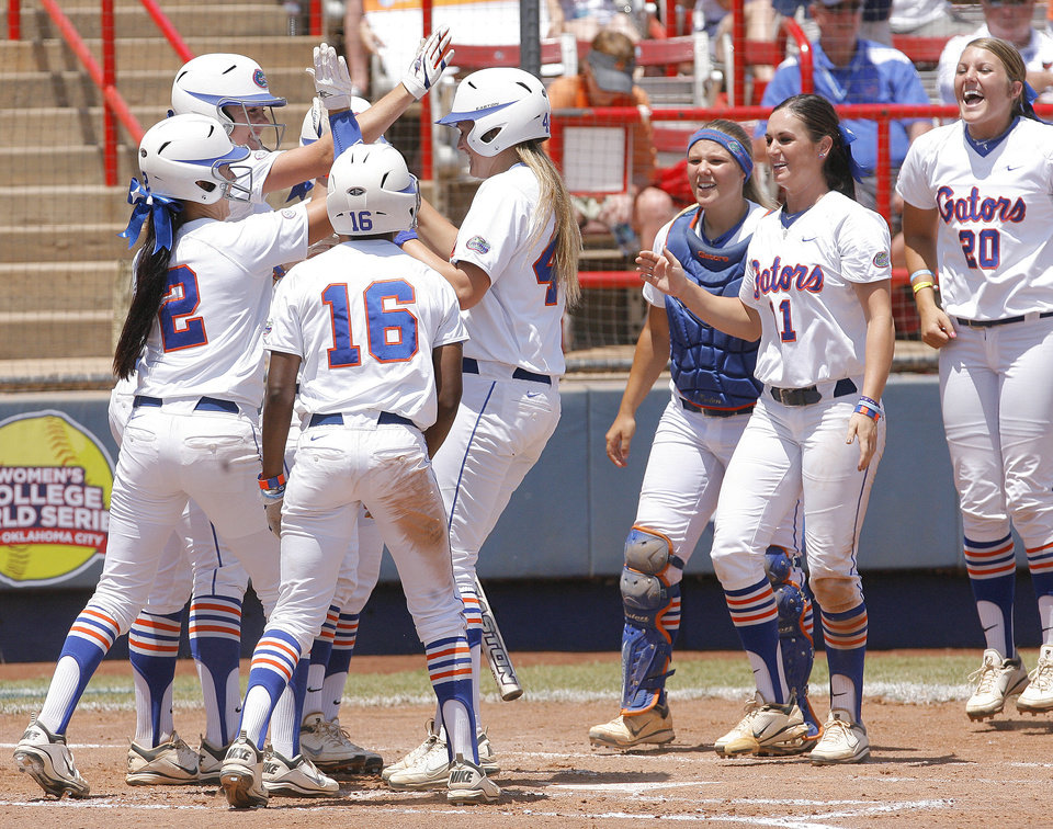 Photo - Florida celebrates a homerun by Brittany Schutte (44) during the Women's College World Series game between Florida and Alabama at the ASA Hall of Fame Stadium in Oklahoma City, Sunday, June 5, 2011. Photo by Garett Fisbeck, The Oklahoman
