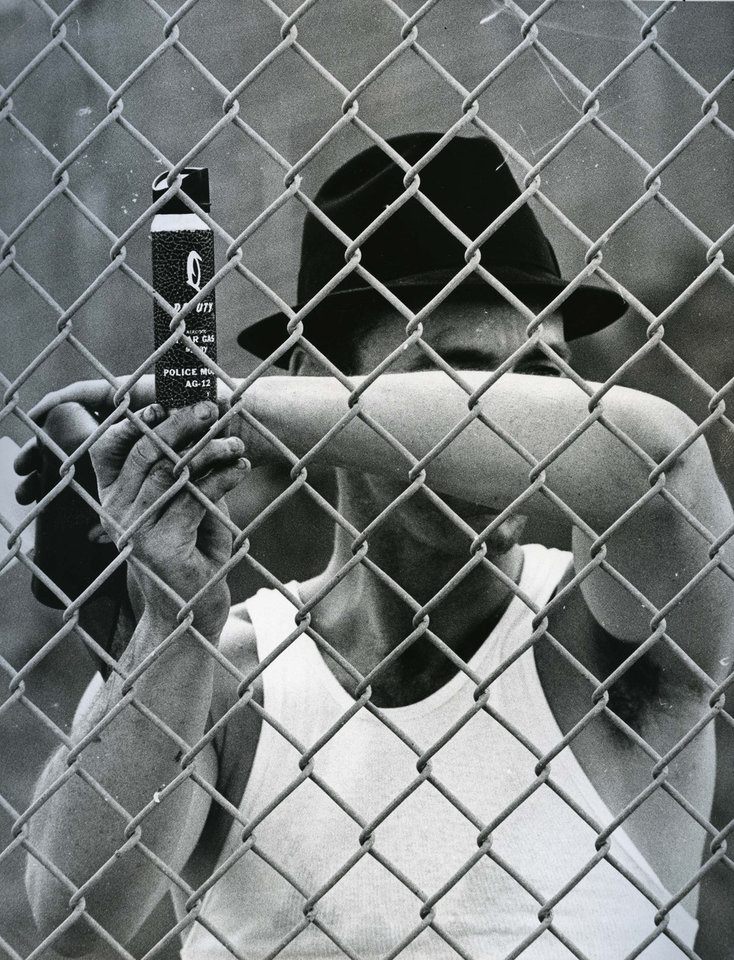Photo - PENAL INSTITUTION / OKLAHOMA STATE PENITENTIARY / McALESTER PRISON RIOT 1973: Unidentified inmate holds can of mace during state prison riot Friday. Staff Photo by Don Tullous. Original photo taken 07/27/1973, published 07/28/1973 in The Daily Oklahoman.