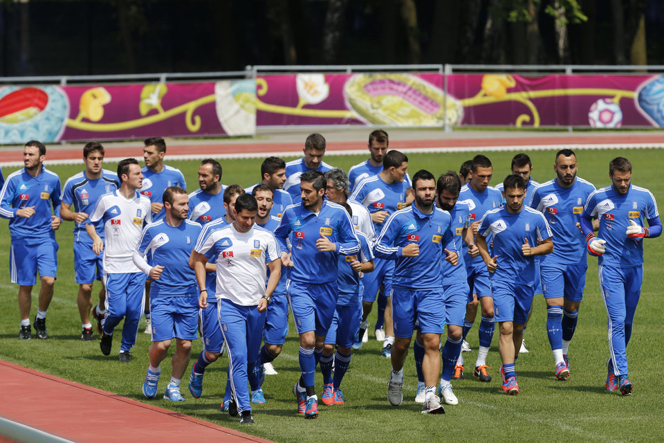 Greece's players run during a training session at the Euro 2012 soccer championship in Legionowo about 25 kilometers (15 miles) north of Warsaw, Poland on Monday, June 18, 2012. (AP Photo/Thanassis Stavrakis)