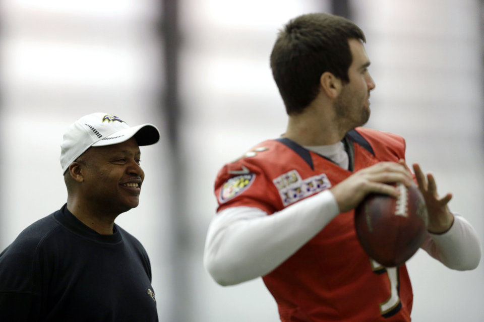 Baltimore Ravens offensive coordinator Jim Caldwell, left, looks on as quarterback Joe Flacco warms up during a practice at the team's practice facility in Owings Mills, Md., Thursday, Jan. 17, 2013. The Ravens are scheduled to face the New England Patriots in the AFC Championship on Sunday. (AP Photo/Patrick Semansky)