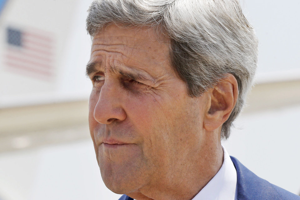 Photo - U.S. Secretary of State John Kerry arrives to Tel Aviv, Israel, Wednesday, July 23, 2014. Kerry is meeting with U.N. Secretary-General Ban Ki-moon, Israeli Prime Minister Benjamin Netanyahu, and Palestinian Authority President Mahmoud Abbas as efforts for a cease-fire between Hamas and Israel continues. (AP Photo/Pool)