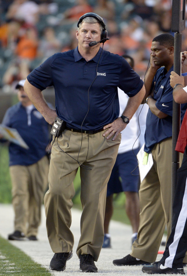 Tennessee Titans head coach Mike Munchak works the sidelines in the first half of an NFL preseason football game against the Cincinnati Bengals, Saturday, Aug. 17, 2013, in Cincinnati. (AP Photo/Michael Keating)