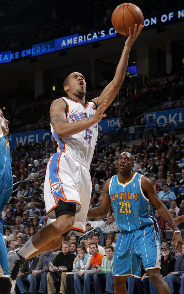 Oklahoma City\'s Eric Maynor (6) goes to the basket as New Orleans\' Quincy Pondexter (20) watches during the NBA basketball game between the Oklahoma City Thunder and the New Orleans Hornets, Wednesday, Feb. 2, 2011 at the Oklahoma City Arena. Photo by Bryan Terry, The Oklahoman