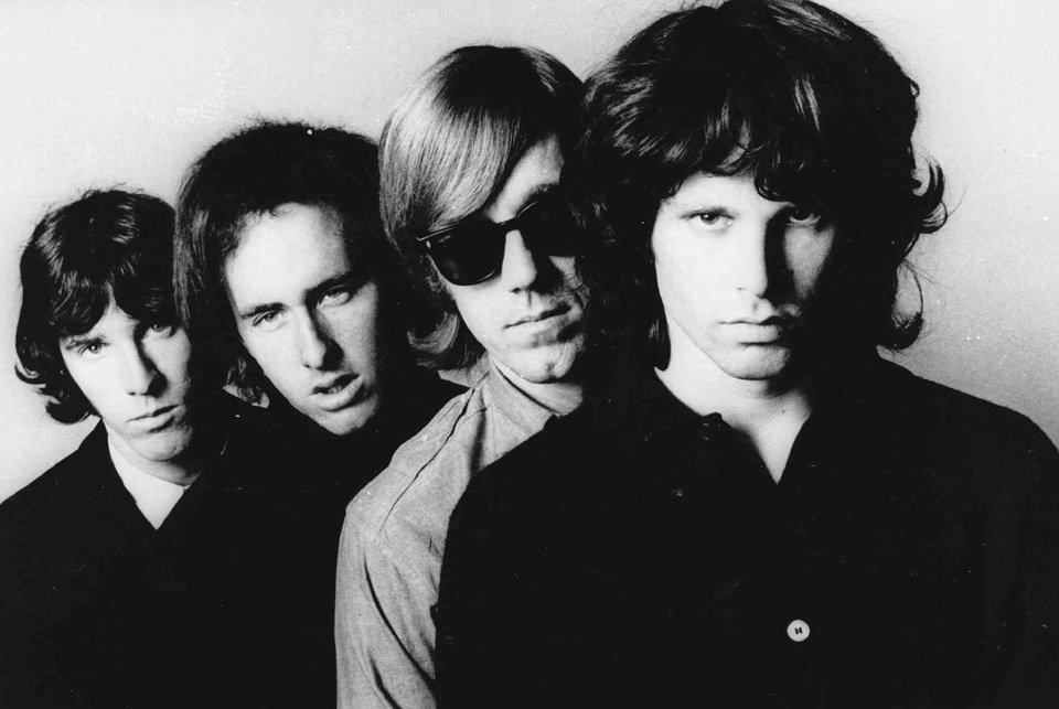 Photo - FILE - In this undated publicity file photo, members of the Doors, from left,  John Densmore, Robbie Krieger, Ray Manzarek and Jim Morrison, pose for a portrait. Manzarek, the keyboardist who was a founding member of The Doors, has died at 74. Publicist Heidi Robinson-Fitzgerald says in a news release that Manzarek died Monday, May 20, 2013, at the RoMed Clinic in Rosenheim, Germany, surrounded by his family.  (AP Photo, File)