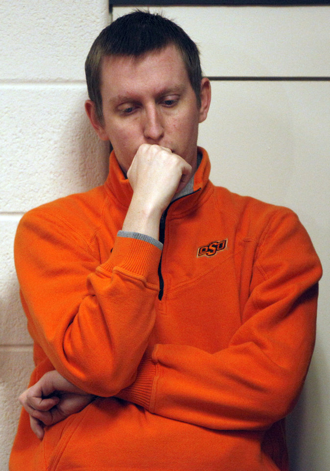 Jordan Smith reacts during a press conference about a plane crash that killed OSU women's head coach Kurt Budke and assistant coach Miranda Serna at Gallagher- Iba Arena in Stillwater, Okla.,  Friday, Nov. 18, 2011.  Photo by Sarah Phipps, The Oklahoman
