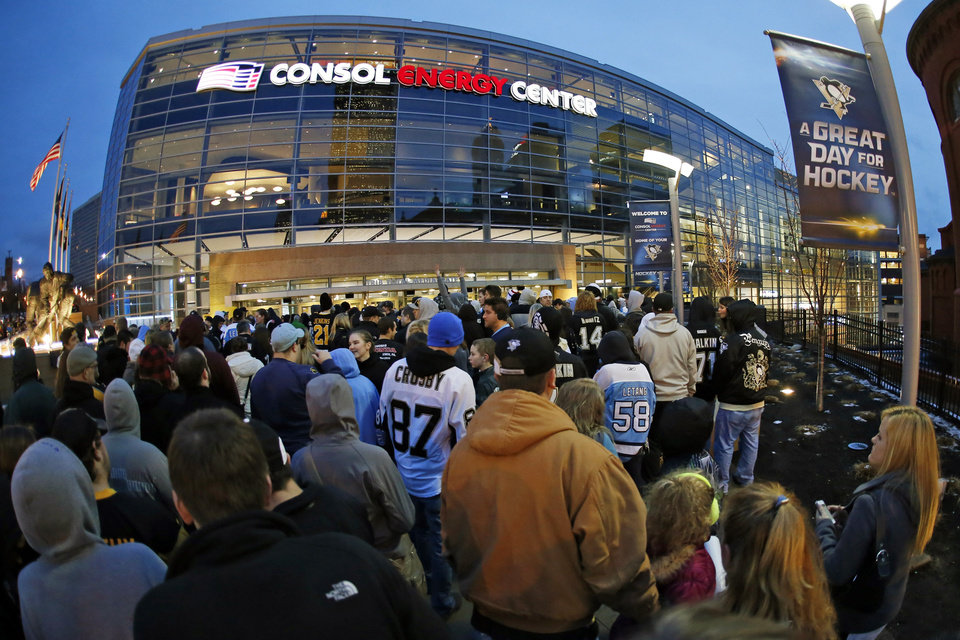 In this photo taken with a fisheye lens, Pittsburgh Penguins fans line up outside Consol Energy Center for an NHL hockey scrimmage in Pittsburgh, Wednesday, Jan. 16, 2013. (AP Photo/Gene J. Puskar)