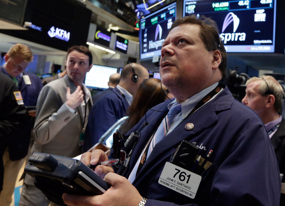 Photo - Trader John Santiago, right, works on the floor of the New York Stock Exchange Friday, May 30, 2014. Two negative reports on U.S. consumers were pushing stocks lower in early trading Friday. (AP Photo/Richard Drew)