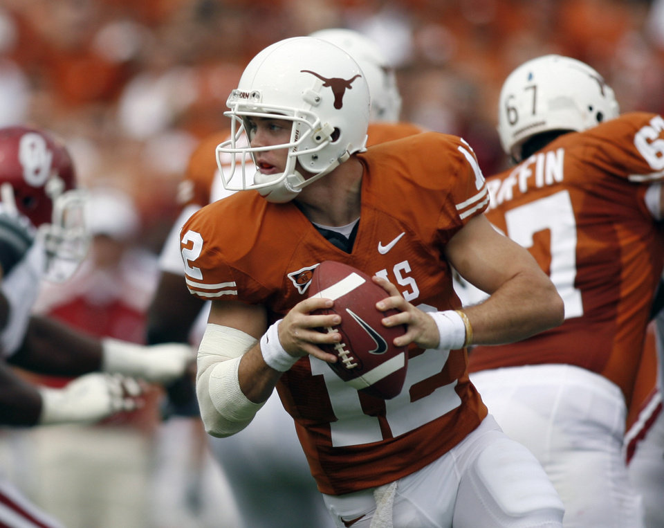 Photo - ** CORRECTS DATE ** University of Texas quarterback Colt McCoy (12) fades back to hand the ball off against the University of Oklahoma (OU) in the first quarter of their NCAA college football game, Saturday, Oct. 6, 2007, in Dallas. (AP Photo/Mike Stone) ORG XMIT: DNB103
