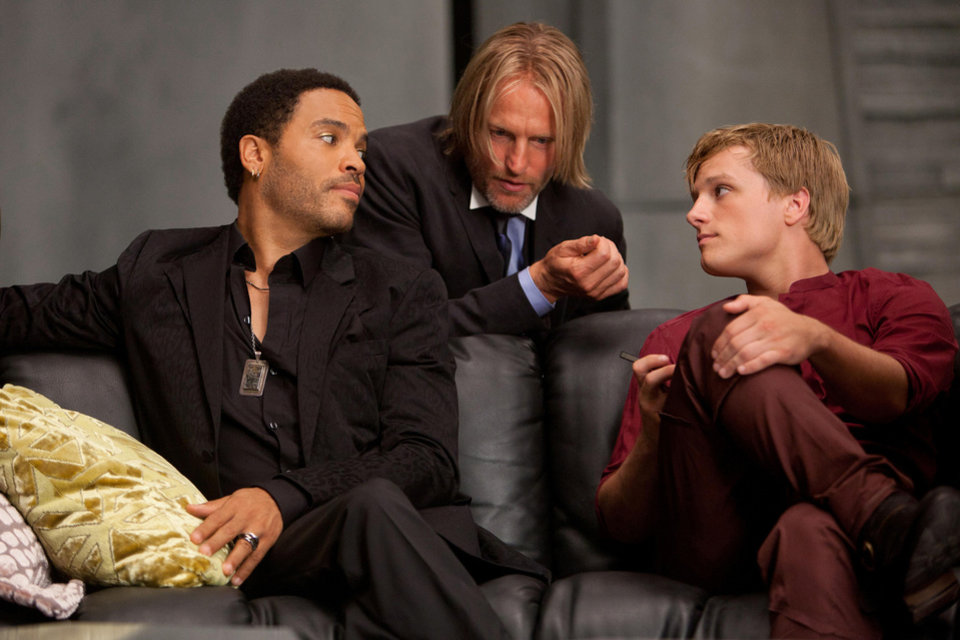 "In this image released by Lionsgate, from left, Lenny Kravitz portrays Cinna, Woody Harrelson portrays Haymitch Abernathy and Josh Hutcherson portrays Peeta Mellark in a scene from ""The Hunger Games."" (AP Photo/Lionsgate, Murray Close) <strong>Murray Close - AP</strong>"