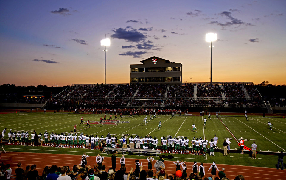 Photo - Edmond Santa Fe plays Yukon during a high school football game at the new stadium in Yukon, Okla., Friday, Sept. 9, 2011. Photo by Bryan Terry, The Oklahoman