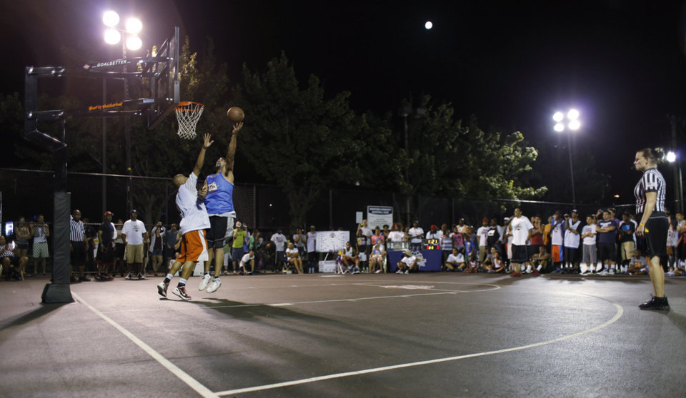 David Godbold (white jersey) and Michael McCowan (blue jersey) meet in the finals during the Red Bull King of the Rock 1-on-1 basketball tournament at The Cage in downtown Oklahoma City Saturday, July 12, 2014. Godbold won the championship. Photo by Doug Hoke, The Oklahoman