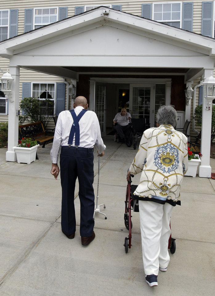 Photo -   Roland Davis and Lena Henderson, both 85, walk back to an apartment complex after posing for photos in West Seneca, N.Y., Tuesday, July 31, 2012. They got married while still in their teens, divorced 20 years later and are getting remarried after nearly a half-century apart. (AP Photo/David Duprey)