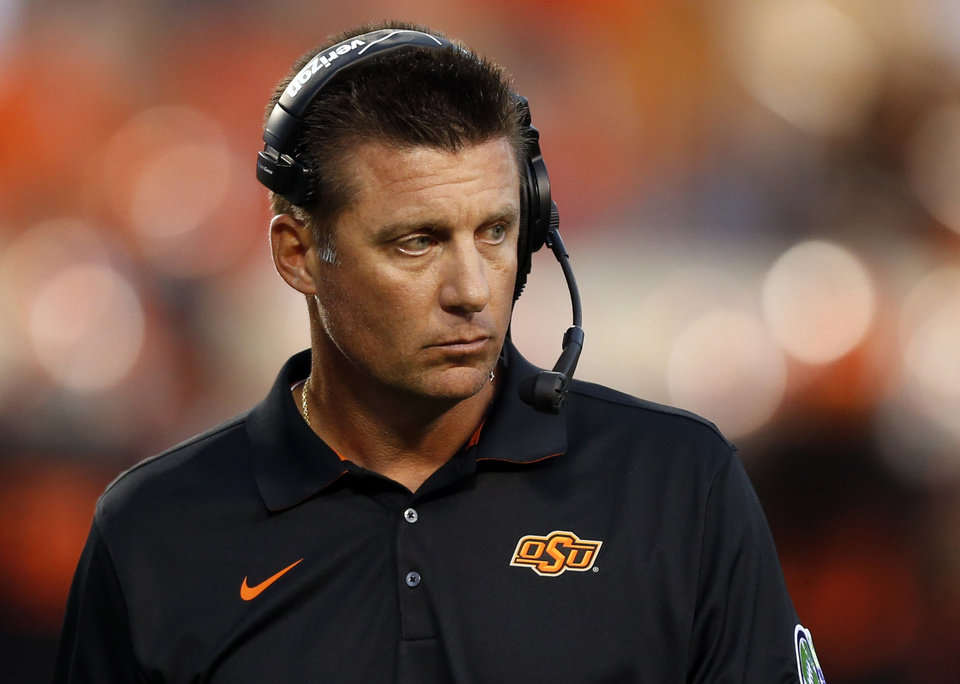 Photo - OSU head coach Mike Gundy during a college football game between the Oklahoma State Cowboys (OSU) and the Texas Tech Red Raiders at Boone Pickens Stadium in Stillwater, Okla., Thursday, Sept. 25, 2014. Photo by Nate Billings, The Oklahoman