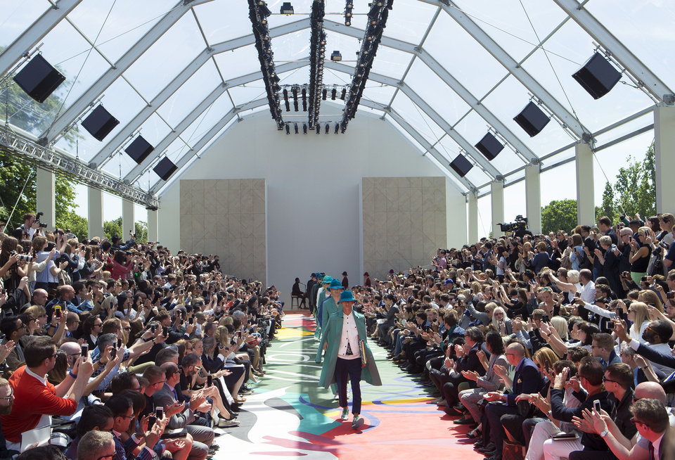 Photo - Models wear creations by Burberry Prorsum during London Collections for Men Spring/Summer 2015 at Kensington Gardens, central London, Tuesday, June 17, 2014. (Photo by Joel Ryan/Invision/AP)