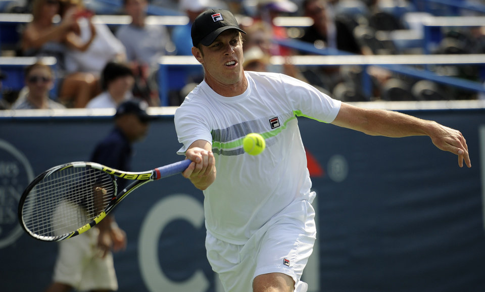 Photo - Sam Querrey reaches for the ball against Kei Nishikori, of Japan, during a match at the Citi Open tennis tournament, Wednesday, July 30, 2014, in Washington. (AP Photo/Nick Wass)