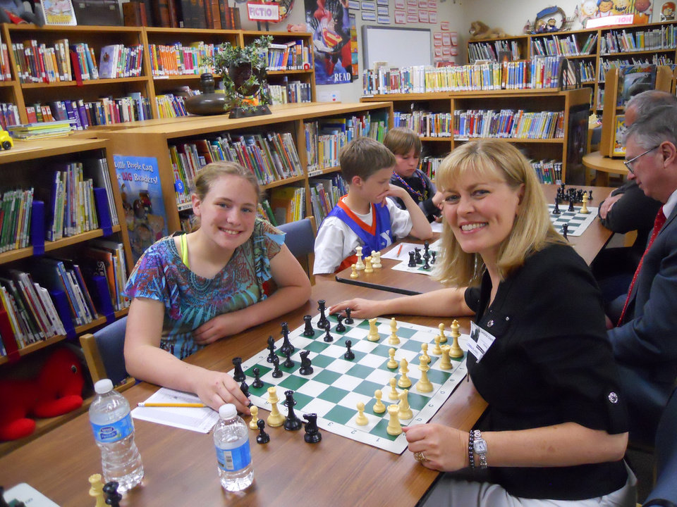 Photo -   Ida Freeman Elementary School Chess Club member Trysta Duerson and Rotarian Sandy Chappell take a break from their game to pose for a photo during the annual Rotary vs. Ida Freeman day. PHOTO PROVIDED      -