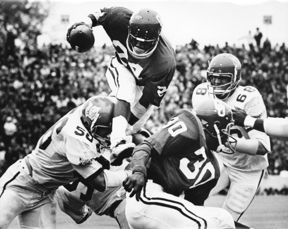 "Photo - UNIVERSITY OF OKLAHOMA: ""If you can't run around 'em, run over 'em --- and that is just what Sooner freshman Joe Washington does against Kansas State.""  Providing a block is teammate Greg Pruitt (30).  The Sooners beat the Wildcats by a 52-0 score. Staff photo by Jim Argo taken 10/28/72; photo ran in the 10/29/72 Daily Oklahoman. File:  College Football/OU/OU-Kansas State/Joe Washington/1972"