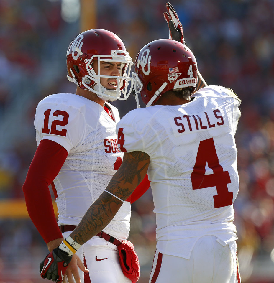 Photo - Oklahoma's Landry Jones (12) and Kenny Stills (4) celebrate after a touchdown during a college football game between the University of Oklahoma (OU) and Iowa State University (ISU) at Jack Trice Stadium in Ames, Iowa, Saturday, Nov. 3, 2012. Oklahoma won 35-20. Photo by Bryan Terry, The Oklahoman
