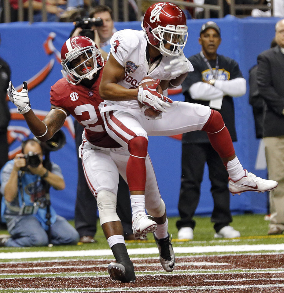 Photo - Oklahoma's Sterling Shepard (3) makes a touchdown catch in front of Alabama's Jarrick Williams (20) during the NCAA football BCS Sugar Bowl game between the University of Oklahoma Sooners (OU) and the University of Alabama Crimson Tide (UA) at the Superdome in New Orleans, La., Thursday, Jan. 2, 2014.  .Photo by Chris Landsberger, The Oklahoman