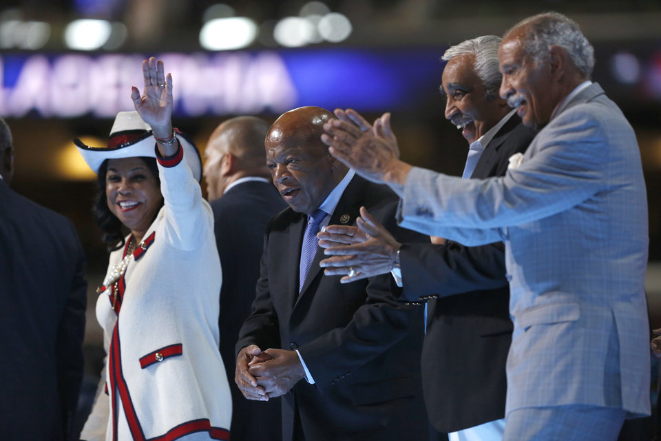 Photo - Members of Congressional Black Caucus Rep. Frederica Wilson, D-Fla., left, Rep. John Lewis, D-Ga., Rep. Charles B. Rangel, D-N.Y., and Rep. John Conyers, D-Mich., applaud from the stage during the third day session of the Democratic National Convention in Philadelphia, Wednesday, July 27, 2016. (AP Photo/Carolyn Kaster)