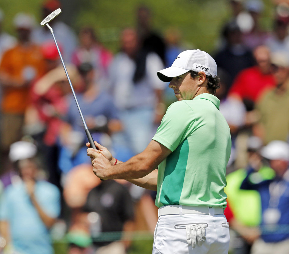 Photo - Rory McIlroy, of Northern Ireland, reacts after missing a putt on the fifth hole during the second round of the Wells Fargo Championship golf tournament in Charlotte, N.C., Friday, May 2, 2014. (AP Photo/Nell Redmond)